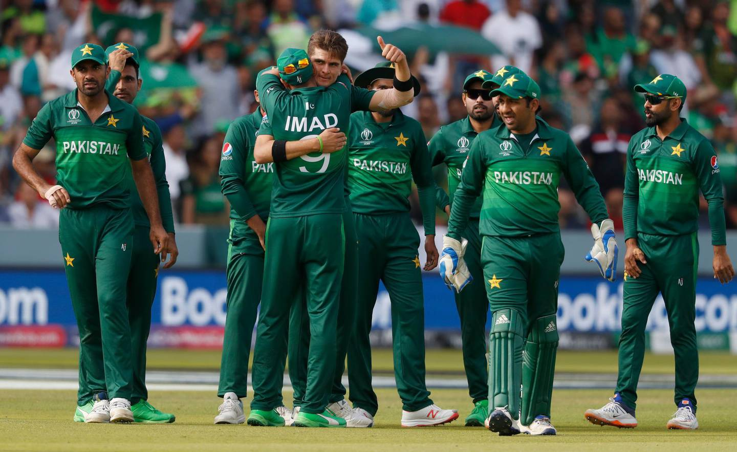 Pakistan's Shaheen Afridi, centre gives a thumbs up as he celebrates with teammates after taking the wicket of Bangladesh's Mahmudullah during the Cricket World Cup match between Pakistan and Bangladesh at Lord's cricket ground in London, Friday, July 5, 2019. (AP Photo/Alastair Grant)