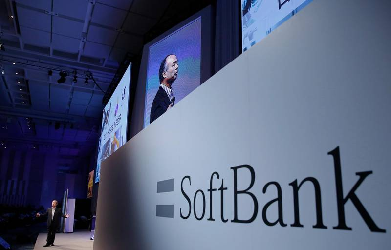 FILE- In this July 20, 2017, file photo, SoftBank Group Corp. Chief Executive Officer Masayoshi Son speaks during a SoftBank World presentation at a hotel in Tokyo. Japanese internet and energy company SoftBank Group Corp. is reporting Wednesday, Feb. 7, 2018, a more than 11-fold surge in profit for the fiscal third quarter thanks to strong sales and to improved results from U.S. carrier Sprint. (AP Photo/Shizuo Kambayashi, File)