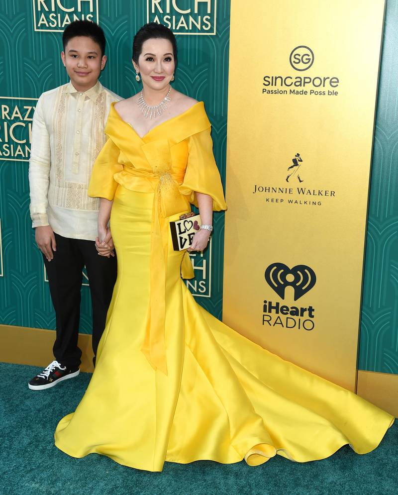 """Bimby Aquino-Yap, left, and Kris Aquino arrive at the premiere of """"Crazy Rich Asians"""" at the TCL Chinese Theatre on Tuesday, Aug. 7, 2018, in Los Angeles. (Photo by Richard Shotwell/Invision/AP)"""