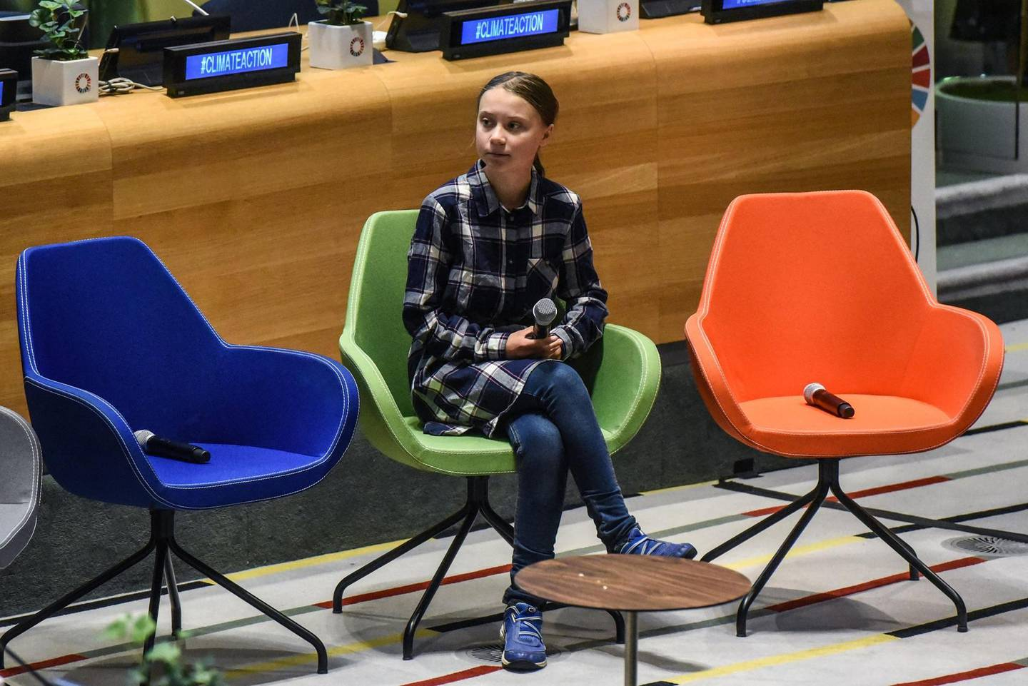 NEW YORK, NY - SEPTEMBER 21: Greta Thunberg sits before speaking at the first ever United Nations Youth Climate Summit on September 21, 2019 in New York City. The Youth Climate Summit is intended to bring together young activists who are committed to combating climate change at the pace and scale needed to meet the challenge.   Stephanie Keith/Getty Images/AFP == FOR NEWSPAPERS, INTERNET, TELCOS & TELEVISION USE ONLY ==