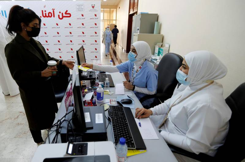 FILE PHOTO: A woman takes her appointment for a second dose of a coronavirus disease (COVID-19) vaccine, at Bahrain International Exhibition & Convention Centre (BIECC), in Manama, Bahrain December 24, 2020. REUTERS/Hamad I Mohammed/File Photo