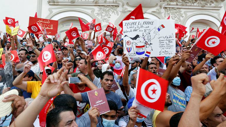 An image that illustrates this article Thousands in Tunis protest President Kais Saied as dozens show support