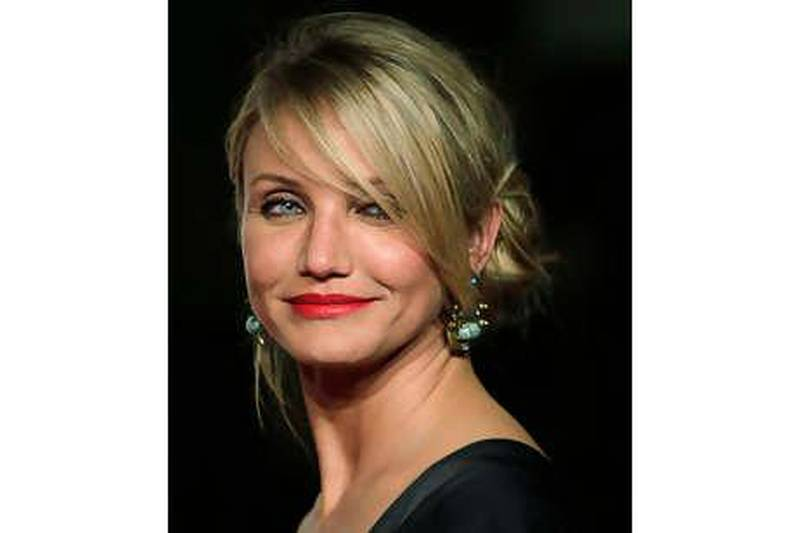 """Cameron Diaz poses during a photo-call for the world premiere of her new film """"Knight and Day"""" at the Lope de Vega theatre in Seville, Spain on Wednesday June 16, 2010.  (AP Photo/Toni Rodriguez)"""