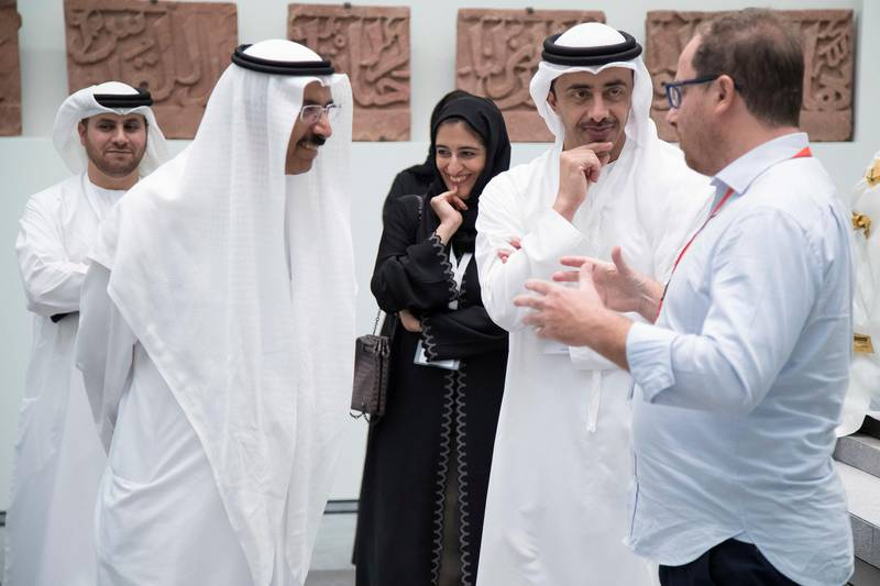 SAADIYAT ISLAND, ABU DHABI, UNITED ARAB EMIRATES -September 11, 2017: HH Sheikh Abdullah bin Zayed Al Nahyan, UAE Minister of Foreign Affairs and International Cooperation (R) and HE Mohamed Al Murr, former Speaker of the UAE Federal National Council (FNC) (L), tour the Louvre Abu Dhabi. Seen with HE Dr Ahmed Mubarak Al Mazrouei, Chairman of the Abu Dhabi Water and Electricity Authority (ADWEA), and Secretary-General of the Executive Council (back L) and HE Najla Al Awar, UAE Minister of Community Development (back R).   ( Omar Al Askar  for The Crown Prince Court - Abu Dhabi ) ---