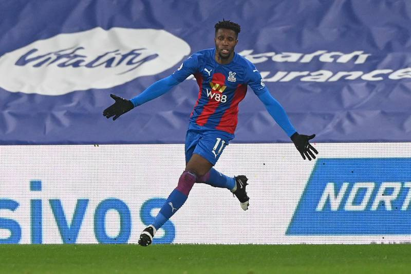 Crystal Palace's Ivorian striker Wilfried Zaha celebrates scoring the opening goal during the English Premier League football match between Crystal Palace and Leicester City at Selhurst Park in south London on December 28, 2020. RESTRICTED TO EDITORIAL USE. No use with unauthorized audio, video, data, fixture lists, club/league logos or 'live' services. Online in-match use limited to 120 images. An additional 40 images may be used in extra time. No video emulation. Social media in-match use limited to 120 images. An additional 40 images may be used in extra time. No use in betting publications, games or single club/league/player publications.  / AFP / POOL / FACUNDO ARRIZABALAGA / RESTRICTED TO EDITORIAL USE. No use with unauthorized audio, video, data, fixture lists, club/league logos or 'live' services. Online in-match use limited to 120 images. An additional 40 images may be used in extra time. No video emulation. Social media in-match use limited to 120 images. An additional 40 images may be used in extra time. No use in betting publications, games or single club/league/player publications.