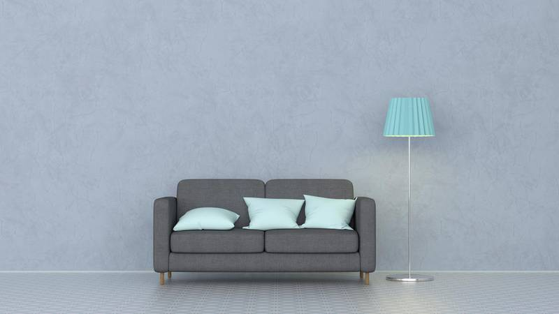 3D rendering, Couch with cushions and floor lamp. Getty Images