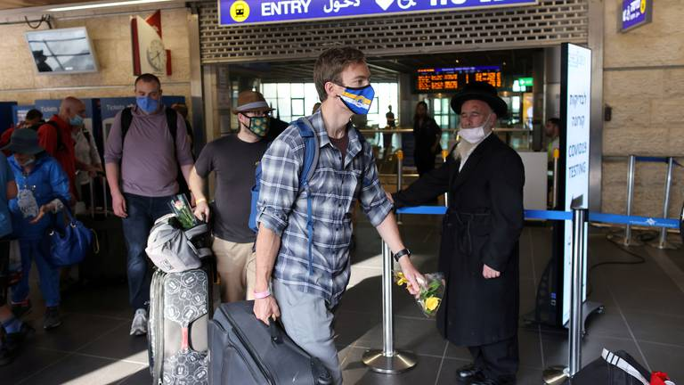 An image that illustrates this article Israel to allow Covid-vaccinated foreign tourists from November