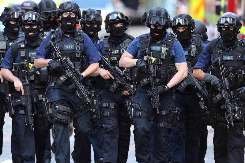 LONDON, ENGLAND - JUNE 04:  Counter terrorism officers march near the scene of last night's London Bridge terrorist attack on June 4, 2017 in London, England. Police continue to cordon off an area after responding to terrorist attacks on London Bridge and Borough Market where 6 people were killed and at least 48 injured last night. Three attackers were shot dead by armed police.  (Photo by Dan Kitwood/Getty Images)