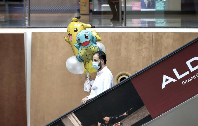 Abu Dhabi, United Arab Emirates, August 2, 2020.   A man with his newly purchased balloons at Al Wahda Mall on the last day of Eid Al Adha. Victor Besa /The NationalSection: NAFor:  Standalone/Stock Images