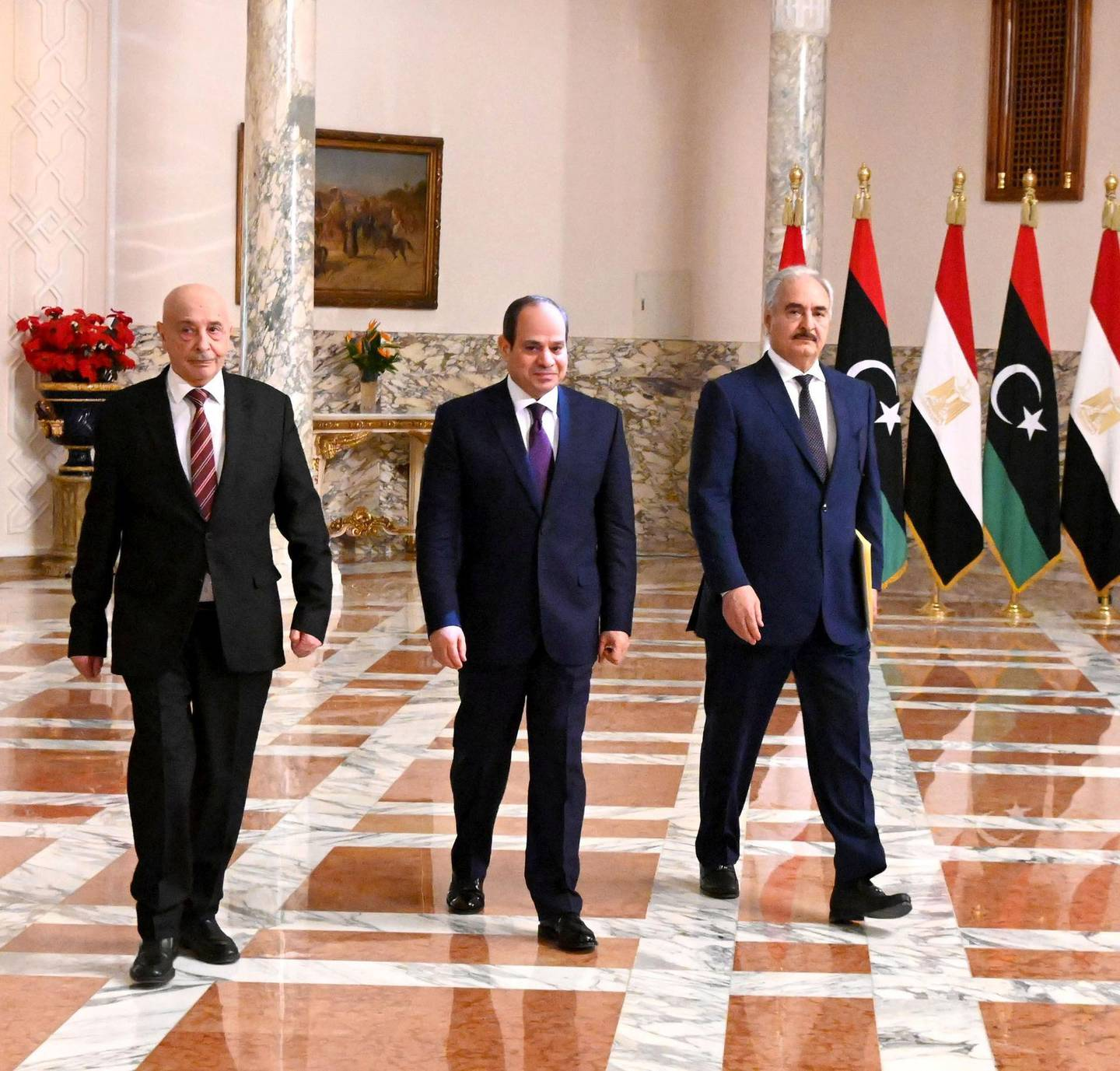 """A handout picture released by the Egyptian Presidency on June 6, 2020 shows Egyptian President Abdel Fattah al-Sisi (C), Libyan commander Khalifa Haftar (R) and the Libyan Parliament speaker Aguila Saleh arriving for a joint press conference in the capital Cairo.  Haftar has backed a ceasefire in Libya starting Monday, Egypt's president announced after talks in Cairo, following a series of military victories by the country's UN-recognised government. - === RESTRICTED TO EDITORIAL USE - MANDATORY CREDIT """"AFP PHOTO / HO / EGYPTIAN PRESIDENCY' - NO MARKETING NO ADVERTISING CAMPAIGNS - DISTRIBUTED AS A SERVICE TO CLIENTS ==  / AFP / EGYPTIAN PRESIDENCY / - / === RESTRICTED TO EDITORIAL USE - MANDATORY CREDIT """"AFP PHOTO / HO / EGYPTIAN PRESIDENCY' - NO MARKETING NO ADVERTISING CAMPAIGNS - DISTRIBUTED AS A SERVICE TO CLIENTS =="""