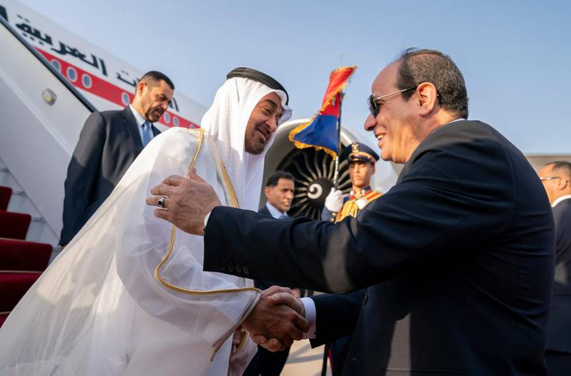 CAIRO, EGYPT - May 15, 2019: HH Sheikh Mohamed bin Zayed Al Nahyan Crown Prince of Abu Dhabi Deputy Supreme Commander of the UAE Armed Forces (L), is received by HE Abdel Fattah El Sisi, President of Egypt (R), upon arrival at Cairo international Airport.( Mohamed Al Hammadi / Ministry of Presidential Affairs )---