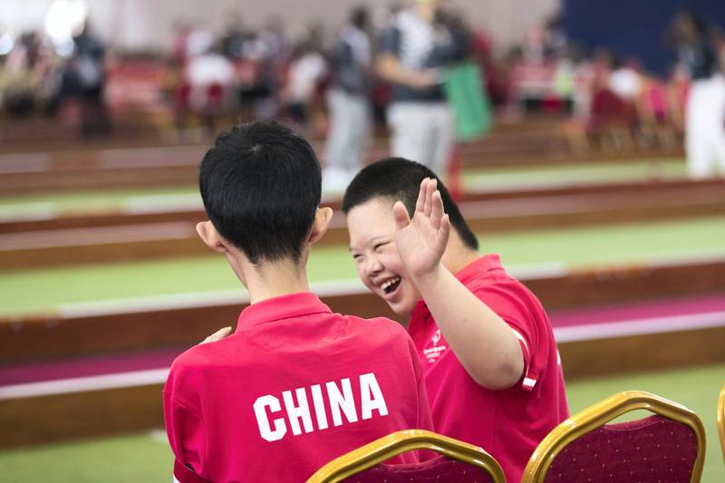 ABU DHABI, UNITED ARAB EMIRATES - March 20 2019.  Chinese bocce athlete cheers on his teammate at the bocce tournament at the Special Olympics World Games in ADNEC.   (Photo by Reem Mohammed/The National)  Reporter:  Section:  NA