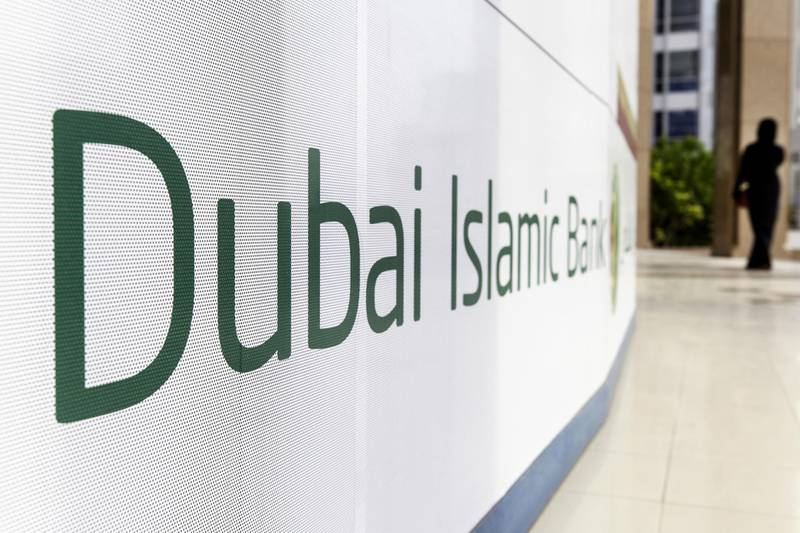 A pedestrian passes signage advertising the Dubai Islamic Bank PJSC bank in Dubai, United Arab Emirates, on Tuesday, Sept. 4, 2018. Abu Dhabi is engineering a second bank merger in its latest attempt to stay competitive in the era of lower oil prices. Photographer: Christopher Pike/Bloomberg