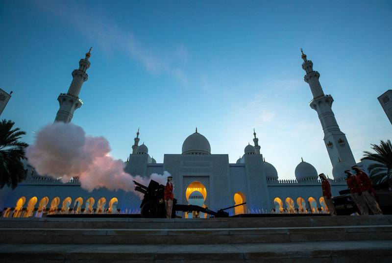 Abu Dhabi, United Arab Emirates, April 13, 2021.  A cannon is fired at Sheikh Zayed Grand Mosque, Abu Dhabi, to mark the beginning of iftar in 2021.  Victor Besa/The NationalSection:  NA