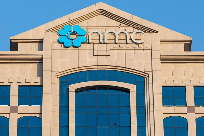 A logo sits on display outside the NMC Speciality Hospital, operated by NMC Health Plc, in Abu Dhabi, United Arab Emirates, on Sunday, March 1, 2020. TroubledNMCHealth Plc, the largest private health-care provider in the United Arab Emirates, asked lenders for an informal standstill on its debt as Abu Dhabi weighs an injection of capital to safeguard the emirate's reputation among global investors. Photographer: Christopher Pike/Bloomberg