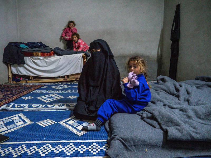 A woman released from Al Hol camp with her children under tribal agreements says she has not been accepted by Syrian communities who accuse her of association with ISIS. Luke Pierce for The National