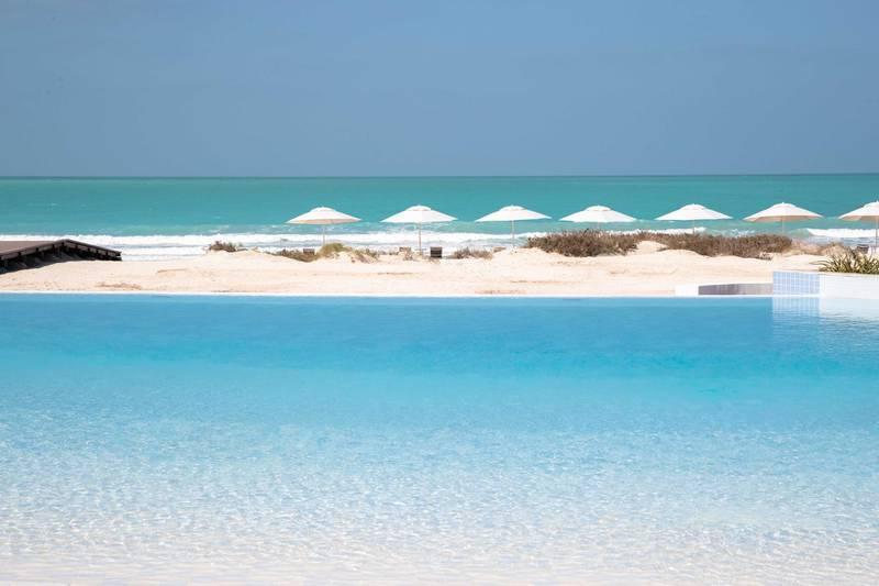 The pool and beach at Jumeirah at Saadiyat Island Resort. Courtesy Jumeirah at Saadiyat Island Resort