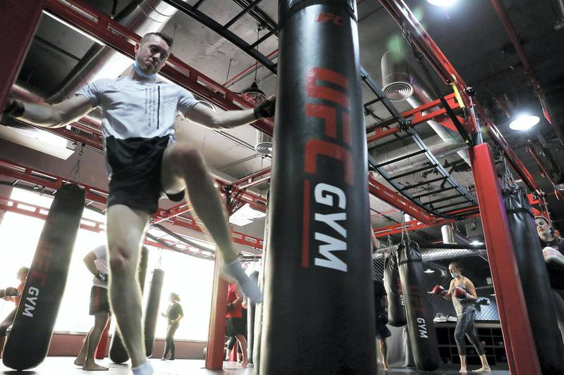 DUBAI, UNITED ARAB EMIRATES , August 10 – 2020 :- Participants during the Kick boxing session at the UFC Gym in Murjan 6 in Jumeirah Beach Residence in Dubai. They are taking part in the 90 minutes MMA Mash up. (Pawan Singh / The National) For News/Online/Instagram. Story by Nick Webster