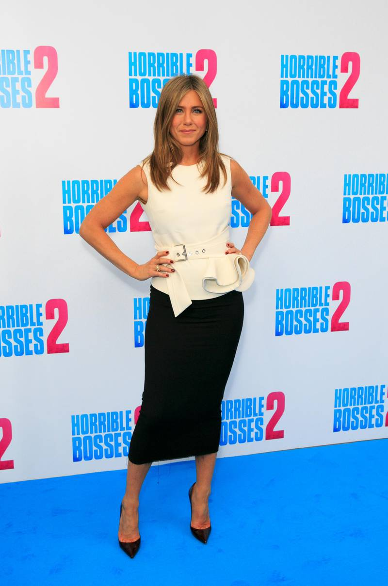 """LONDON, ENGLAND - NOVEMBER 13:  Jennifer Aniston attends the """"Horrible Bosses 2"""" photocall at Corinthia Hotel London on November 13, 2014 in London, England.  (Photo by Dave J Hogan/Getty Images)"""