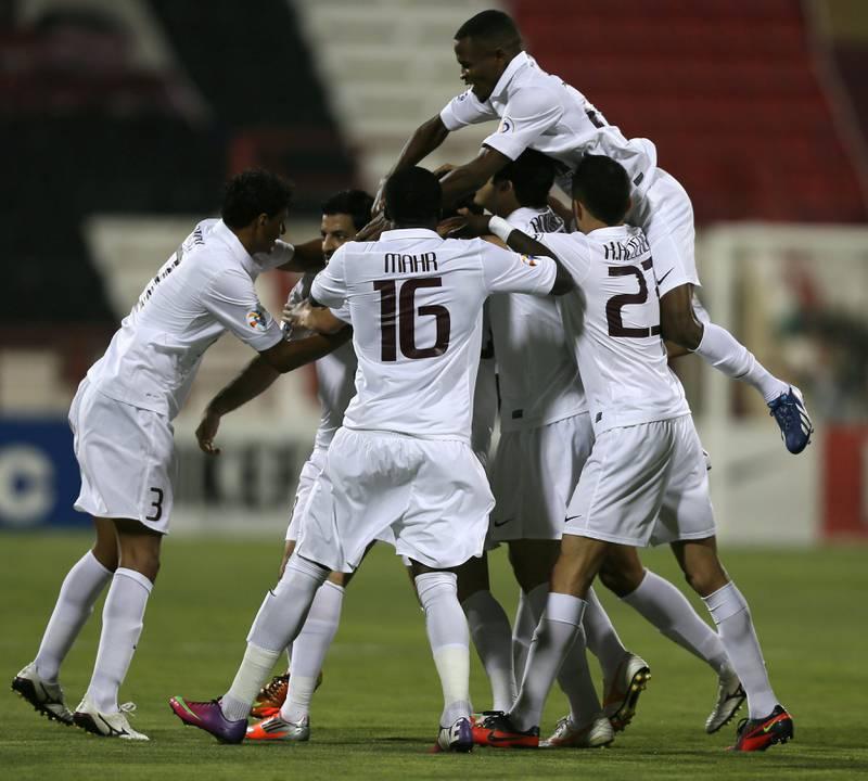 Qatar's Al-Jaish players celebrate after scoring a goal against UAE's Al-Jazira club during their AFC Champions League soccer match in Doha on April 2, 2013. AFP PHOTO /AL-WATAN DOHA / KARIM JAAFAR == QATAR OUT  *** Local Caption ***  825245-01-08.jpg