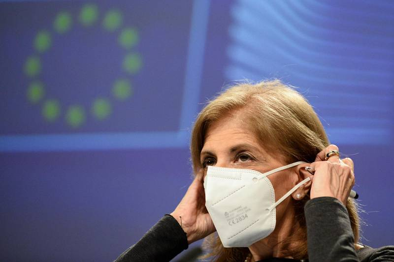 European Commissioner in charge of Health Stella Kyriakides removes her face mask during an online news conference at the EU headquarters in Brussels, Friday, Jan. 29, 2021. The European Union and AstraZeneca agreed Friday to make public a heavily redacted version of their coronavirus vaccine agreement, which lies at the heart of a dispute over how many shots the pharmaceutical company should be supplying the EU's 27 nations. (Johanna Geron, Pool Photo via AP)