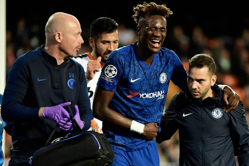 Chelsea's English striker Tammy Abraham is helped after resulting injured during the UEFA Champions League Group H football match between Valencia CF and Chelsea FC at the Mestalla stadium in Valencia on November 27, 2019. / AFP / JAVIER SORIANO
