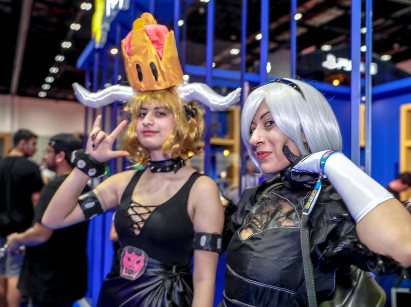 Dubai, April 12, 2019.  MEFCC day 2-Comic Con goers at full swing on day 2.  --Sana Khan as Bowsette of Mario Bros. and Mariam Khan as 2B from Neir.Victor Besa/The National.Section:  AC  Reporter:  Chris Newbould