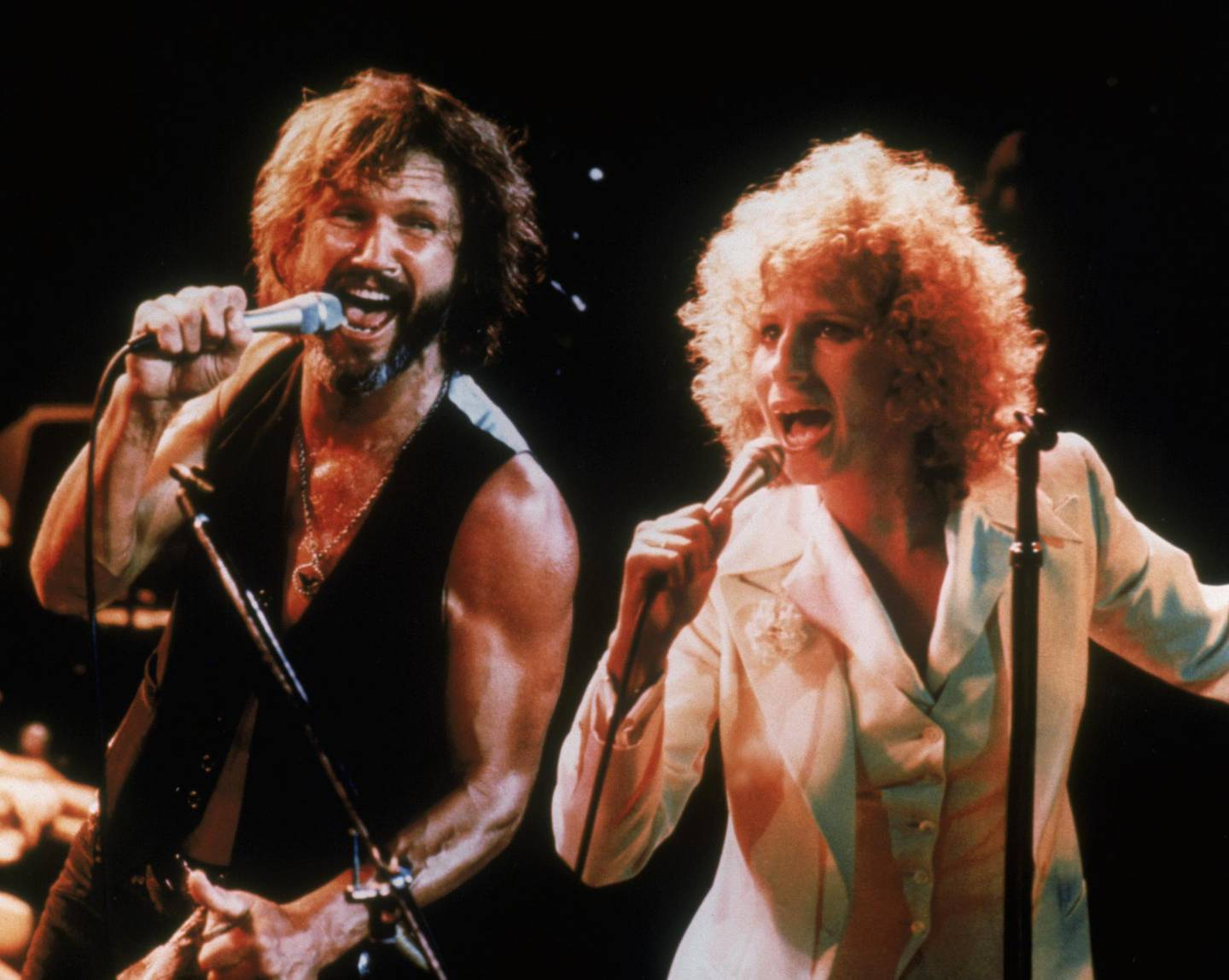 """RELEASE DATE: 1976. DIRECTOR: Frank Pierson. STUDIO: Warner Brothers. PLOT: Talented rock star John Norman Howard (Kris Kristofferson) has seen his career begin to decline. Too many years of concerts and managers and life on the road have made him cynical and the monotony has taken its toll. Then he meets the innocent, pure and very talented singer Esther Hoffman (Barbra Streisand). As one of his songs in the movie says """"I'm gonna take you girl, I'm gonna show you how."""" And he does. He shows Esther the way to stardom while forsaking his own career. As they fall in love, her success only makes his decline even more apparent. A love story for the time - and a great film it is. PICTURED: BARBRA STREISAND, KRIS KRISTOFFERSON. Courtesy Warner Bros."""