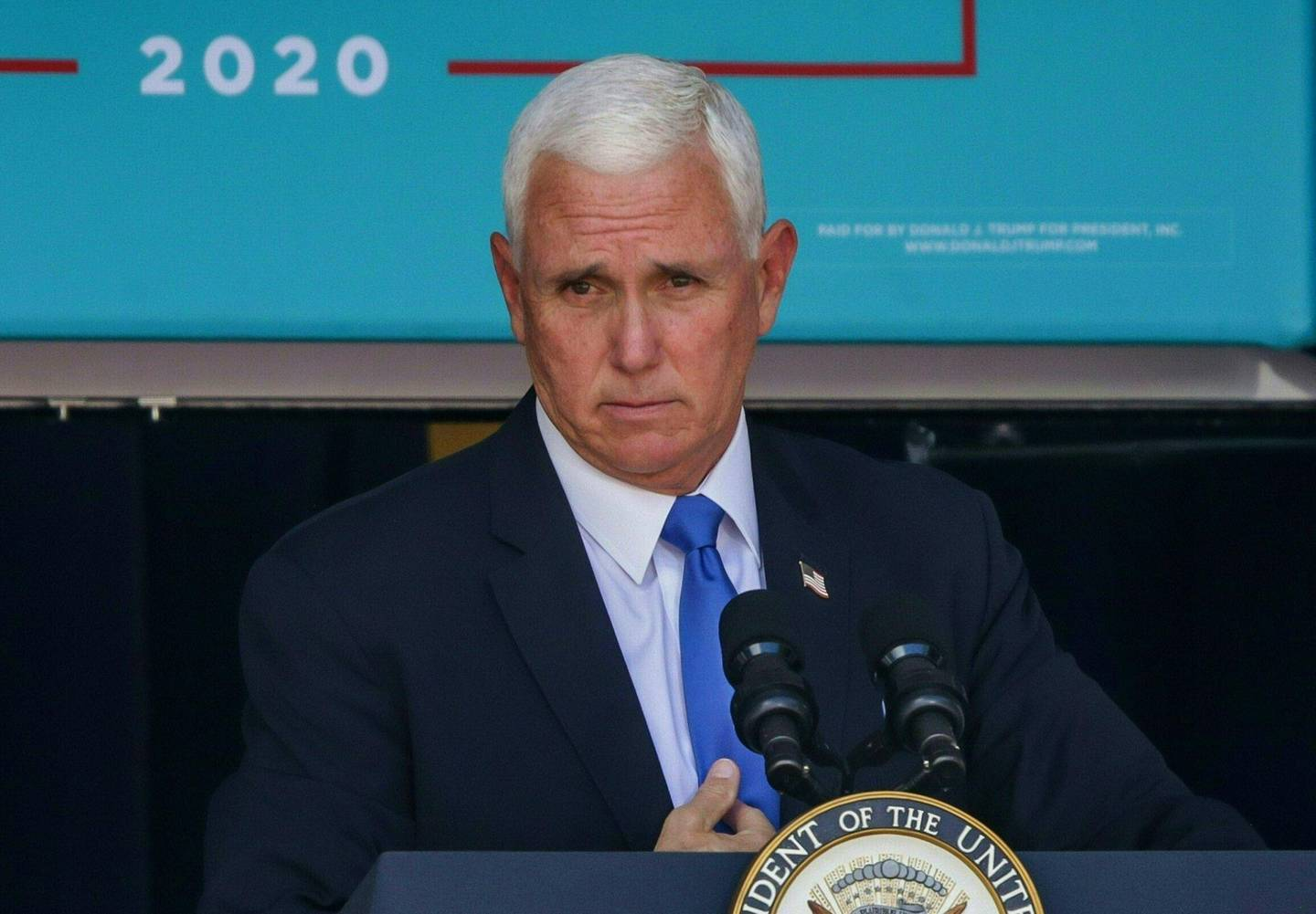 (FILES) In this file photo US Vice President Mike Pence speaks at a Latinos For Trump rally in Orlando, Florida on October 10, 2020.   US Vice President Mike Pence is opposed to using the constitution's 25th Amendment to force President Donald Trump from office, despite pressure from democrats and some Republicans, the New York Times reported on January 7, 2021. While Pence has not spoken publicly about invoking the mechanism, never used before in US history, the newspaper cited a person close to the vice president saying he is against the radical move. / AFP / Zak BENNETT