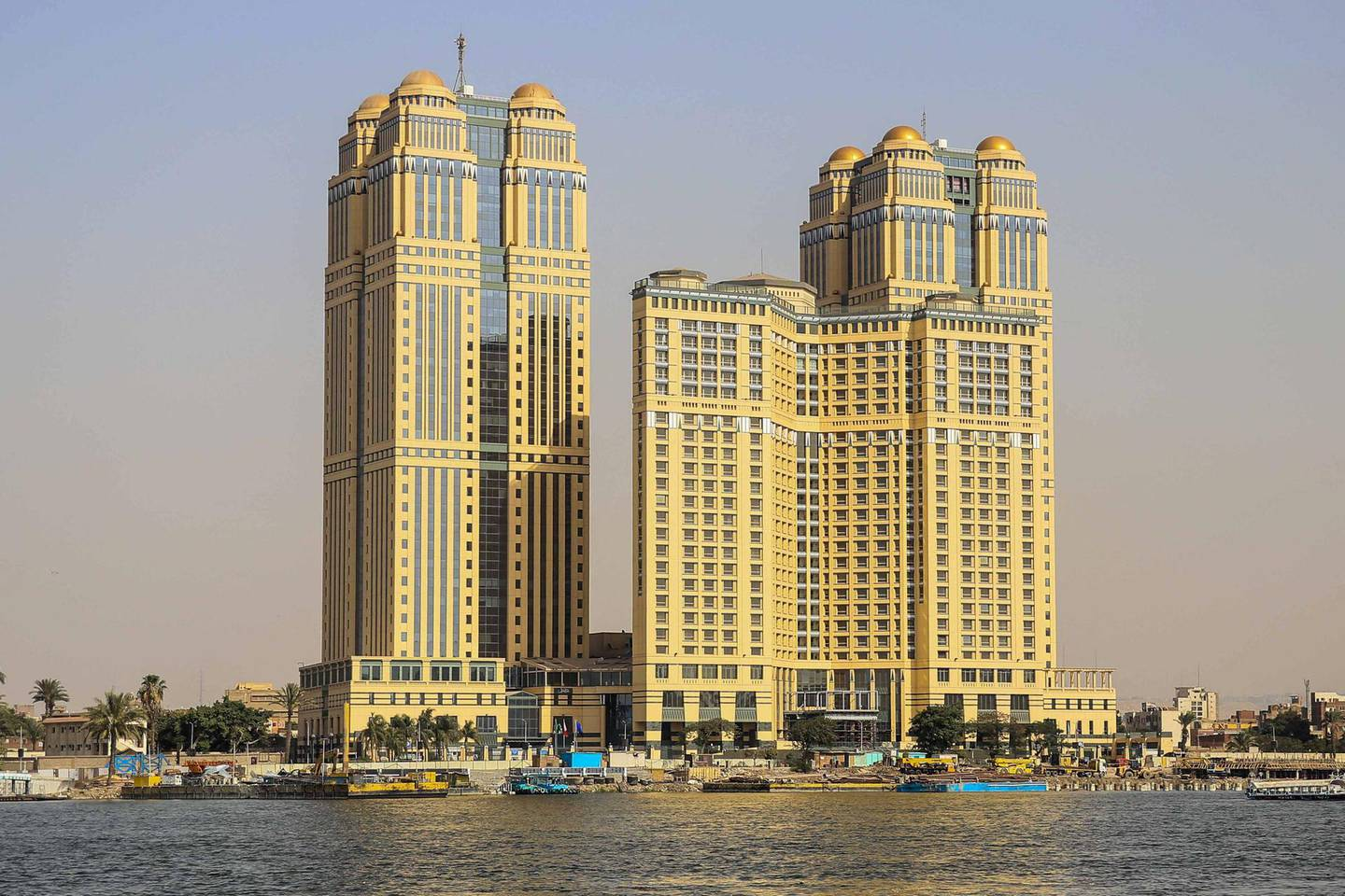 A general view taken on July 30, 2020 shows the five-star Fairmont Nile City hotel, where an alleged sexual assault took place in 2014, in the Egyptian capital Cairo. - A gang rape allegation at a luxury hotel in Egypt stemming from a prominent social media account has triggered a new #MeToo wave in the deeply conservative country. The alleged assault took place at the five-star Fairmont Nile City hotel in Cairo in 2014 where a group of six men drugged and raped a young woman, according to several social media accounts (Photo by Samer ABDALLAH / AFP)