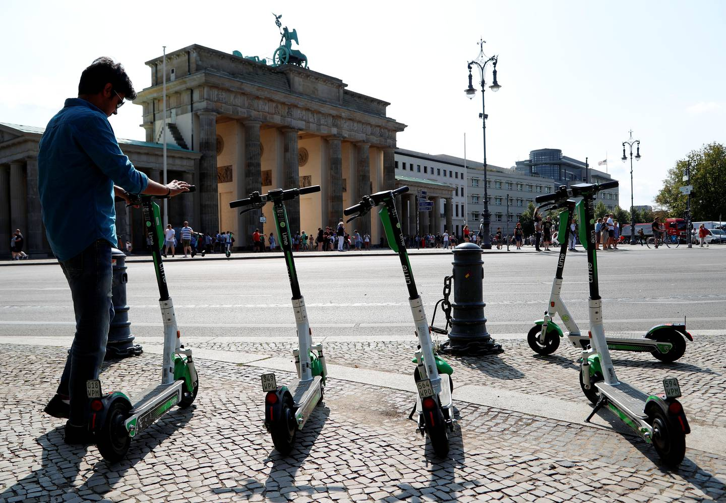 E-scooters of California-based bicycle service Lime are pictured by the Brandenburg Gate in Berlin, Germany, August 8, 2019. REUTERS/Fabrizio Bensch
