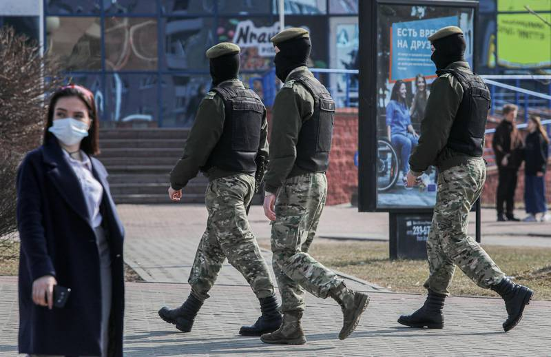 Belarusian law enforcement officers patrol a street, as opposition supporters gather for a rally against President Alexander Lukashenko in Minsk, Belarus March 27, 2021. BelaPAN via REUTERS ATTENTION EDITORS - THIS IMAGE WAS PROVIDED BY A THIRD PARTY. MANDATORY CREDIT.