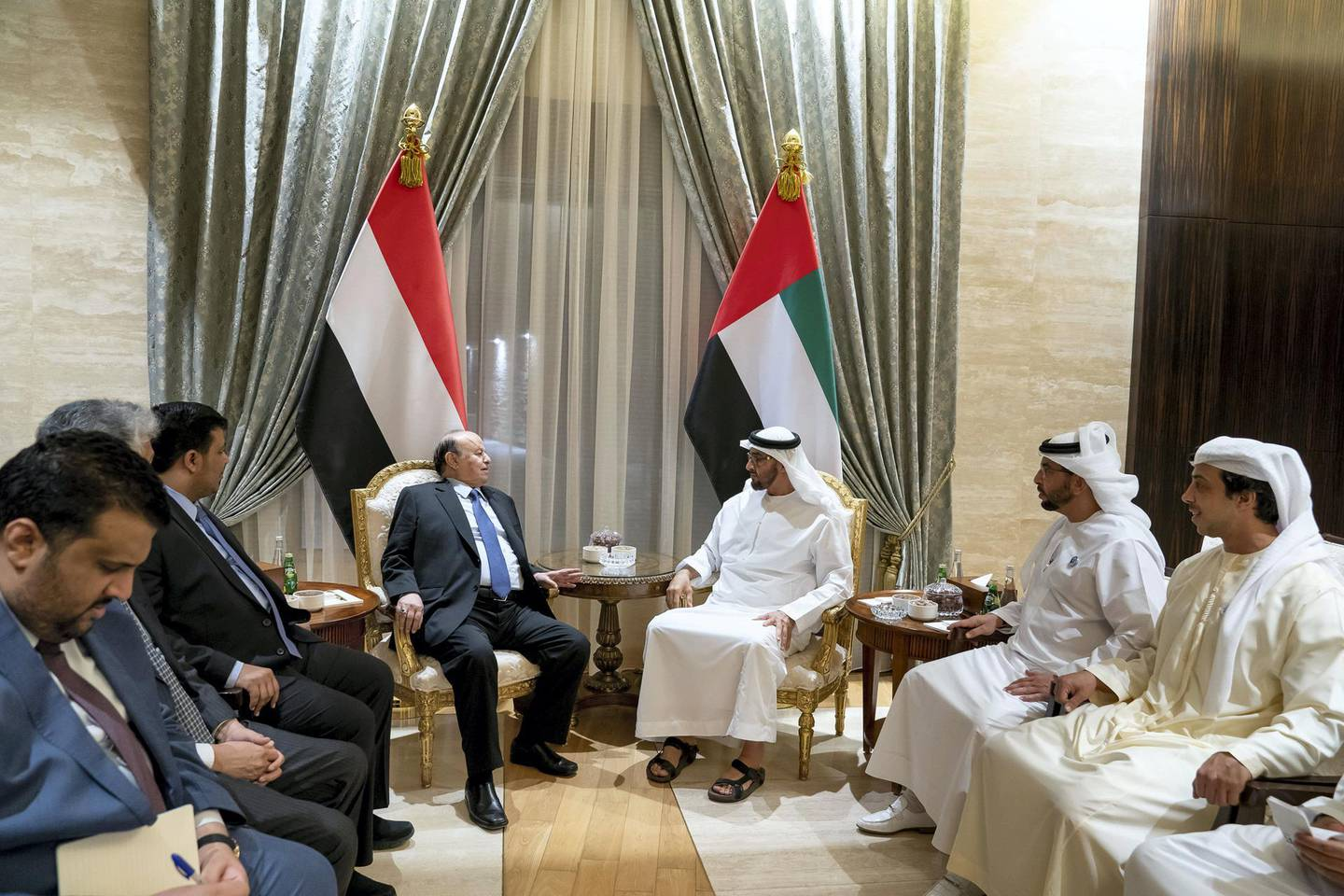 ABU DHABI, UNITED ARAB EMIRATES - June 12, 2018: HH Sheikh Mohamed bin Zayed Al Nahyan Crown Prince of Abu Dhabi Deputy Supreme Commander of the UAE Armed Forces (3rd R) meets with HE Abdrabbuh Mansour Hadi President of Yemen (4th R), at Al Shati Palace. Seen with HH Sheikh Mansour bin Zayed Al Nahyan, UAE Deputy Prime Minister and Minister of Presidential Affairs (R) and HH Sheikh Hamdan bin Zayed Al Nahyan, Ruler's Representative in Al Dhafra Region (2nd R).  ( Mohamed Al Hammadi / Crown Prince Court - Abu Dhabi ) ---