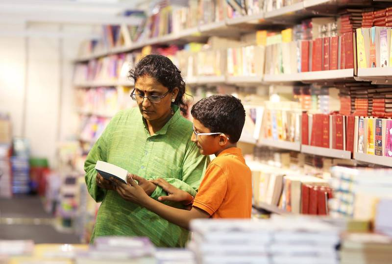 SHARJAH , UNITED ARAB EMIRATES – Nov 4 , 2015 : People browsing the books at the book stalls on the first day of Sharjah International Book Fair at Expo Centre in Sharjah. ( Pawan Singh / The National ) For News *** Local Caption ***  PS0411- BOOK FAIR02.jpg