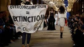 Climate stage activist storms catwalk at Paris Fashion Week