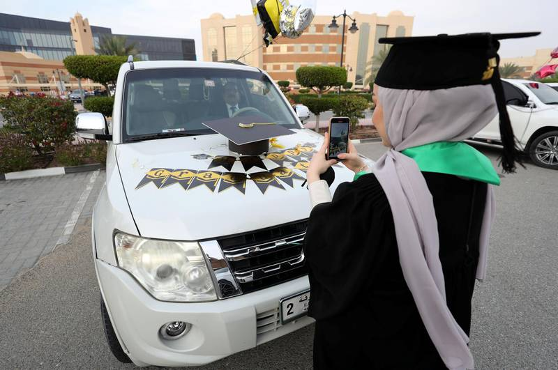 Ajman, United Arab Emirates - Reporter: Anam Rizvi. News. A student takes a picture of her car before her drive through graduation from Ajman University because of Covid-19. Wednesday, February 10th, 2021. Ajman. Chris Whiteoak / The National