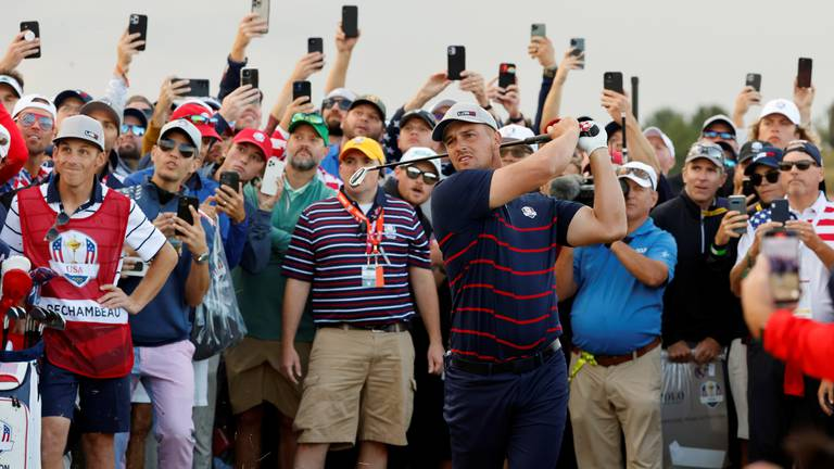An image that illustrates this article Today's best photos: From The Ryder Cup to Merkel feeding birds