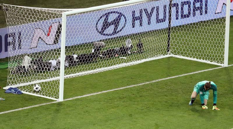 Soccer Football - World Cup - Group B - Portugal vs Spain - Fisht Stadium, Sochi, Russia - June 15, 2018   Spain's David de Gea concedes the second goal scored by Portugal's Cristiano Ronaldo   REUTERS/Lucy Nicholson