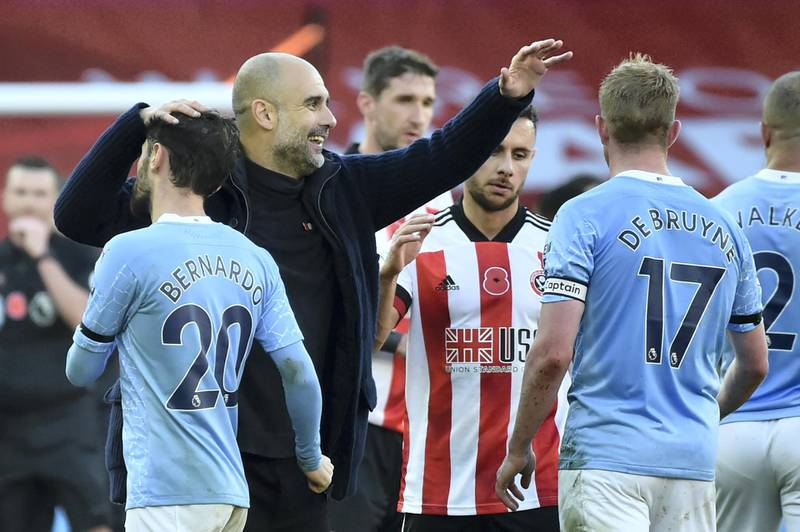 Manchester City's Spanish manager Pep Guardiola reacts at the final whistle during the English Premier League football match between Sheffield United and Manchester City at Bramall Lane in Sheffield, northern England on October 31, 2020. (Photo by Rui Vieira / POOL / AFP) / RESTRICTED TO EDITORIAL USE. No use with unauthorized audio, video, data, fixture lists, club/league logos or 'live' services. Online in-match use limited to 120 images. An additional 40 images may be used in extra time. No video emulation. Social media in-match use limited to 120 images. An additional 40 images may be used in extra time. No use in betting publications, games or single club/league/player publications. /
