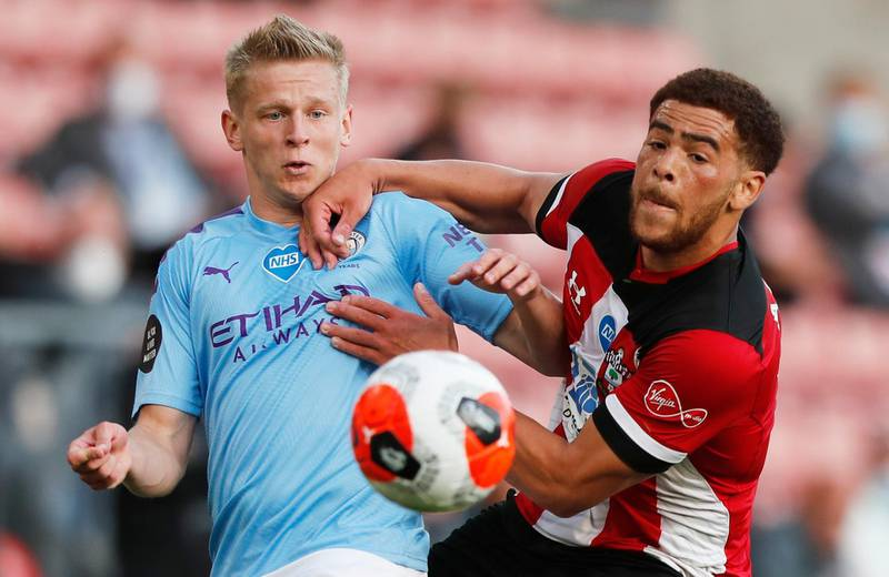 """Soccer Football - Premier League - Southampton v Manchester City - St Mary's Stadium, Southampton, Britain - July 5, 2020  Manchester City's Oleksandr Zinchenko in action with Southampton's Che Adams, as play resumes behind closed doors following the outbreak of the coronavirus disease (COVID-19) Frank Augstein / Pool via REUTERS  EDITORIAL USE ONLY. No use with unauthorized audio, video, data, fixture lists, club/league logos or """"live"""" services. Online in-match use limited to 75 images, no video emulation. No use in betting, games or single club/league/player publications.  Please contact your account representative for further details."""