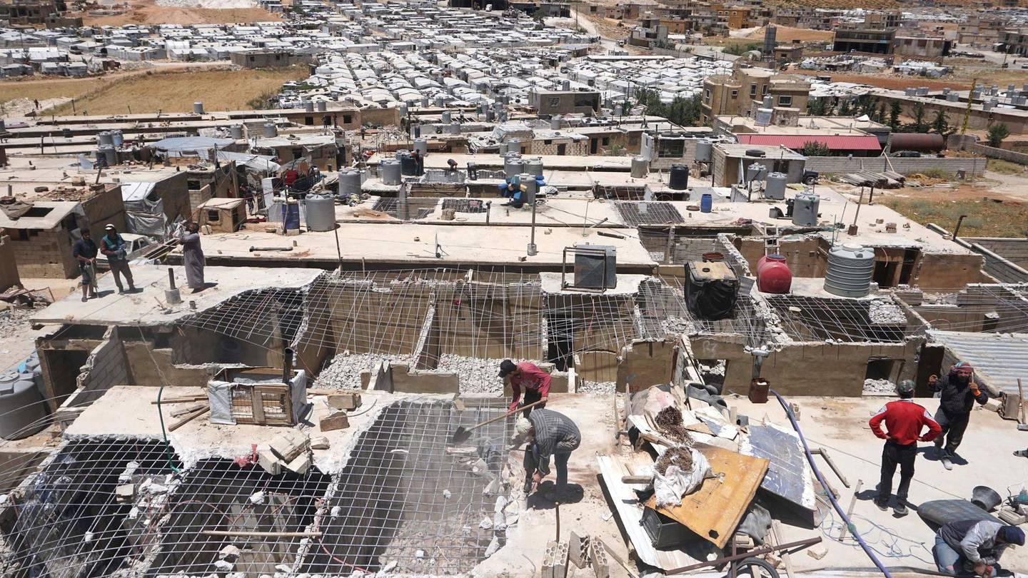 Rooftop view of Qarya Hayat camp, Arsal, of men destroying their own homes. Sunniva Rose / The National