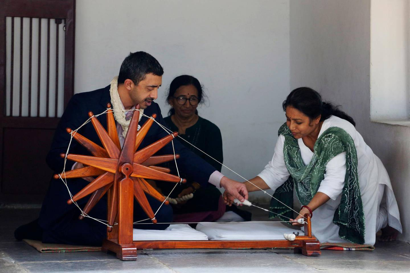 UAE Foreign Minister Abdullah bin Zayed Al Nahyan tries his hands on a spinning wheel during his visit to the Mahatma Gandhi Ashram in Ahmadabad, India, Wednesday, June 27, 2018. (AP Photo/Ajit Solanki)
