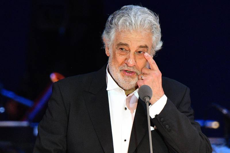 """(FILES) In this file photo taken on August 28, 2019 Spanish tenor Placido Domingo gestures as he performs during his concert in the newly inaugurated sports and culture centre 'St Gellert Forum' in Szeged, southern Hungary. Opera star Placido Domingo, who is facing multiple allegations of sexual harassment, on February 25, 2020 apologised for """"the hurt"""" caused to his accusers, saying he accepted """"full responsibility"""" for his actions. / AFP / Attila KISBENEDEK"""