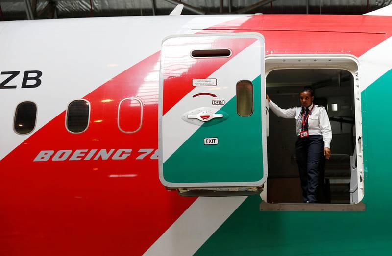 A Kenya Airways staff member is seen at the rear door of a Boeing Dreamliner 787-8 inside a hangar at their headquarters in Nairobi, Kenya June 27, 2018. REUTERS/Thomas Mukoya