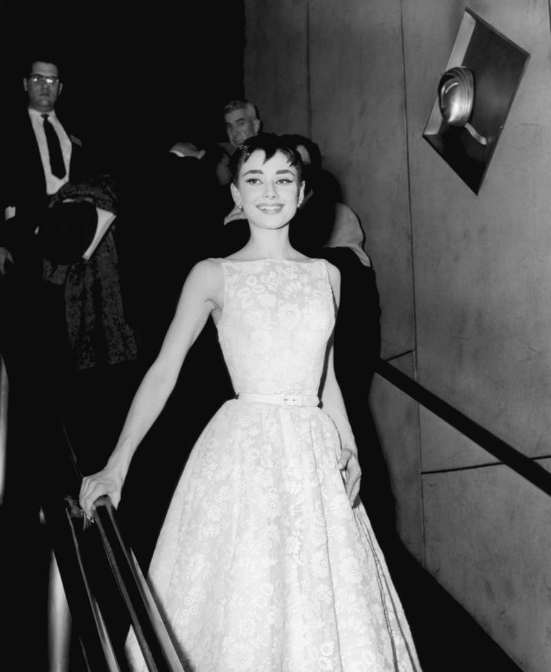 26TH ANNUAL ACADEMY AWARDS -- Pictured: Actress Audrey Hepburn, wearing a Givenchy gown, at the 26th Annual Academy Awards at the NBC Century Theatre in New York City, on March 25, 1954  (Photo by NBCU Photo Bank/NBCUniversal via Getty Images via Getty Images)