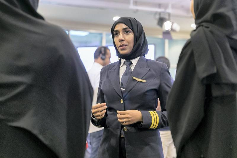 """ABU DHABI, UNITED ARAB EMIRATES - AUG 22: Salma al Baloushi, Etihad's first woman pilot, talks to young female Etihad employees.Etihad Aviation Group celebrated Emirati Women's Day 2017 by organizing a panel under the title: """"Emirati Women Partners In Giving – Between the Past and Present"""", which featured several successful female Emirati Etihad staff who work across the spectrum of our operations, including engineering, legal, flight and airport operations.(Photo by Reem Mohammed/The National)Reporter: RAMOLA TALWARSection: NA"""
