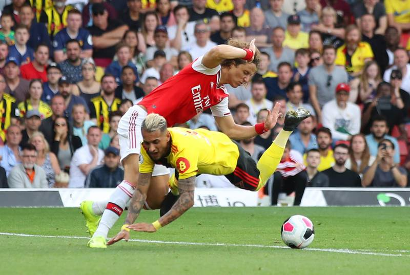 WATFORD, ENGLAND - SEPTEMBER 15:  Roberto Pereyra of Watford is fouled by David Luiz of Arsenal for a penalty during the Premier League match between Watford FC and Arsenal FC at Vicarage Road on September 15, 2019 in Watford, United Kingdom. (Photo by Marc Atkins/Getty Images)