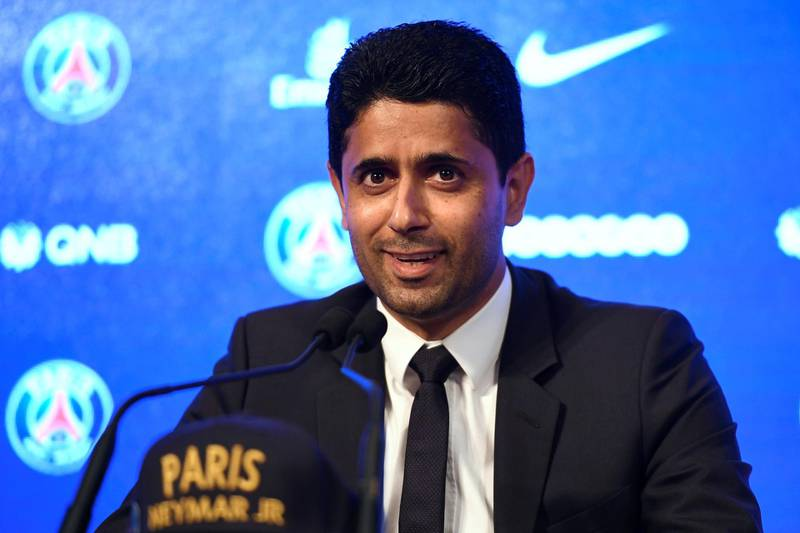 """Paris Saint Germain's (PSG) Qatari president Nasser Al-Khelaifi speaks during a press conference to present Brazilian superstar Neymar at the Parc des Princes stadium on August 4, 2017 in Paris after agreeing a five-year contract following his world record 222 million euro ($260 million) transfer from Barcelona to PSG. Paris Saint-Germain have signed Brazilian forward Neymar from Barcelona for a world-record transfer fee of 222 million euros (around $264 million), more than doubling the previous record. Neymar said he came to Paris Saint-Germain for a """"bigger challenge"""" in his first public comments since arriving in the French capital. / AFP PHOTO / Lionel BONAVENTURE"""
