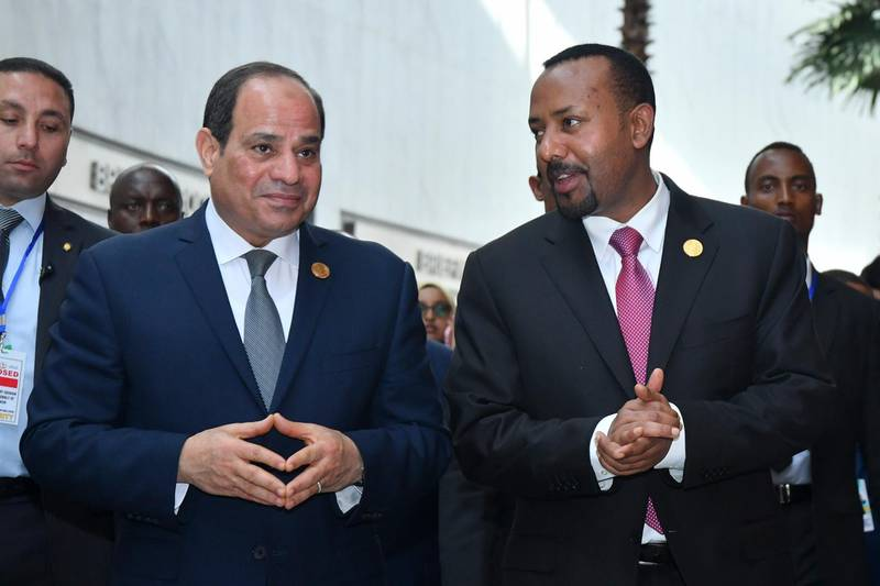 epa07358385 Egyptian President Abdel Fattah al-Sisi (L) and Prime Minister of Ethiopia Abiy Ahmed (R) chat during the 32nd African Union Summit in Addis Ababa, Ethiopia, 10 February 2019. African heads of state and business leaders are gathering in Ethiopian capital for a two-day summit under the theme 'Refugees, Returnees and Internally Displaced Persons: Towards Durable Solutions to Forced Displacement in Africa'.  EPA/STRINGER