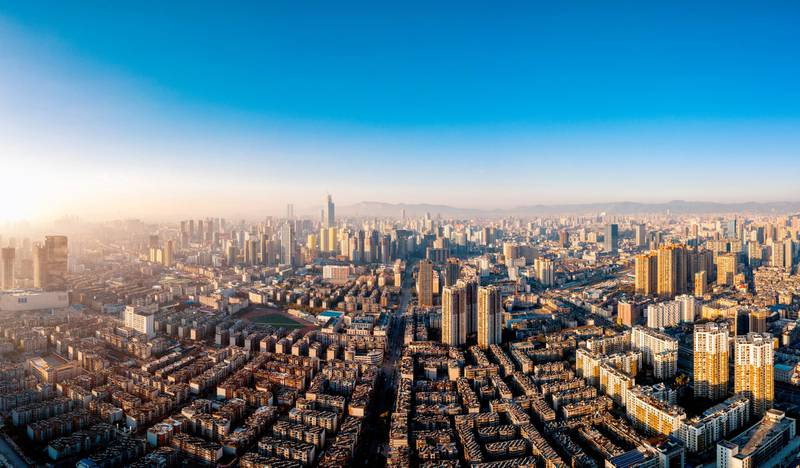 Beautiful Sunset view and cityscape photo taken in Kunming, the capital city of Yunnan Province, China.   The exact location of this photo is Xinxing road 116 near the 2nd ring.  Photo taken on 01/20/2019 by drone device